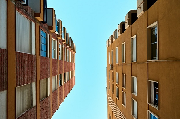 Low angle shot of apartment buildings against clear sky background
